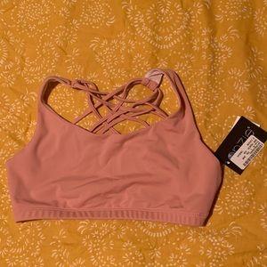 Strappy pink sports bra